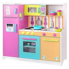Entice your pint-sized chef to explore their culinary genius with the Large Pastel Play Kitchen from KidKraft, featuring a fridge, microwave, stove-top and oven fit to prepare a banquet.