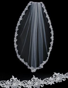 Edged in a delicate Venice lace with a few rhinestones and bugle beads, this wedding veil is fingertip length, 36 inches long and 72 inches wide, on a four inch