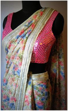 Floral saree with gold and silver lace border paired with pink mirror work blouse