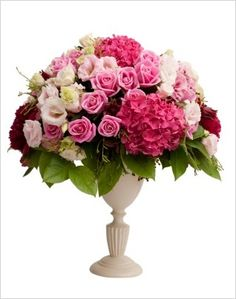 A beautiful pink flower centerpiece of pink hydrangeas, pink roses and light pink lisianthus. Perfect for an English themed wedding.