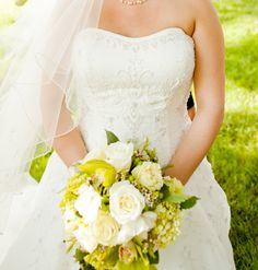 Cascade green and white bouquet including green hydrangea, white roses, green cymbidium orchids and white wax flower
