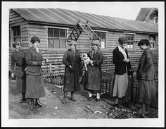 Members of the First Aid Nursing Yeomanry outside one of their huts by National Library of Scotland, via Flickr