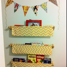 Fabric bookshelves in our babies nursery