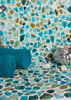 From the Riva Del Mar Collection is Aqua Marino. This stone-embedded tile is perfect for various settings including: bathrooms; backsplashes; kitchens; floors; walls; showers; steam rooms; and pools.