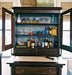 Antique piece with blue interior turned into bar