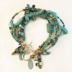 Love the bracelet, not the price!    Boho style, beaded, turquoise, multi-strand bracelet with bronze freshwater pearls, glass seed beads and shells in Southwest style, beadwork