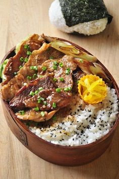 BBQ Pork bento box, with sides of grilled onion, sweet pickled turnip, and sesame salt rice.