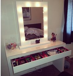 $150. Malm dressing table from Ikea for makeup storage