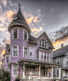 lavender painted lady. Oh, just look at that cool attic window on the turret roof!