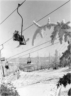 A skier rode the Mt. Mansfield single chair lift as it crossed Stowe's Lord trail in 1976.