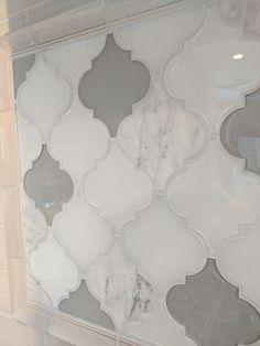 ON SALE NOW!!! Closeup of creative arabesque kitchen backsplash | Mix of Clover Arabesque Blanco mosaic glass tile and Clover Arabesque Grigio tile creates a unique Moroccan kitchen backsplash