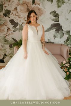 This sophisticated ball gown is for the timeless and classic bride! It features a high neckline with plunging V-neck illusion, open back and full tulle skirt. If you are looking for an elegant wedding dress, this is it! Charlotte's Weddings is a Portland, Oregon bridal shop with the largest selection of wedding dresses in the areas including plus size wedding dresses over a size 18. See more of this gown and other wedding dresses from the Julia Leigh collection at charlottesweddings.com. Classic Wedding Dress, Gown Wedding, Dream Wedding Dresses, Designer Wedding Dresses, Allure Bridal, Plus Size Wedding, Portland Oregon, Illusion, Ball Gowns