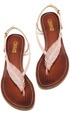 Pretty feather sandals.