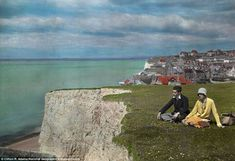 Glorious photographs show and Britain using Autochrome Looking out: Two young adults sit in the grass by a cliff near water and the village of Rottingdean in East Sussex in 1931 Old Pictures, Old Photos, Vintage Photos, Vintage Pins, Color Photography, Vintage Photography, Jane Austen, Subtractive Color, Colorized Photos