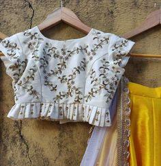 Yellow silk lehenga with ivory ruffle blouse fabilicious fashion Lengha Blouse Designs, Choli Blouse Design, Blouse Designs Silk, Saree Blouse, Simple Blouse Designs, Stylish Blouse Design, Kids Blouse Designs, Designs For Dresses, Looks Style