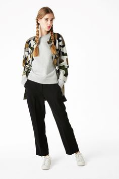 A glorious pair of soft flowy trousers with two side slanting pockets, a hidden zip and hook and bar closure and elasticated waist band at the back.