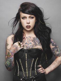 Megan Massacre. Not only is she a kick ass tattoo artist. She's a little hottie :)