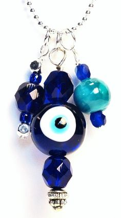 Evil Eye Pendant Charm Necklace by belacjewelry on Etsy,This whimsical Evil Eye necklace is sure to ward off evil spirits! It is made up of glass and Czech beads in several different blue hues including the large Evil Eye bead in the middle.The silver ball chain measures 18 inches.Each piece of jewelry comes with a jewelry box.