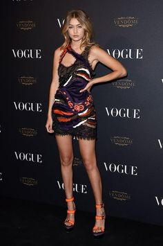 FASHION PASSPORT TV - VOGUE PARIS 95TH ANNIVERSARY PARTY GIGI HADID IN VERSACE #GigiHadid attended the Vogue Paris 95th Anniversary Party on Friday (October 3) in Paris. The model stuns in a Versace Spring 2016 fringe embroidered frock.