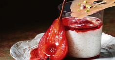 Traditional rice pudding gets a gourmet touch. Serve this glammed-up version with a red-tinged syrup and delicious poached pears for extra oomph.