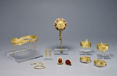 Collection of Ptolemaic jewelry (16); Unknown; Egypt; 220 - 100 B.C.; Gold with various inlaid and attached stones, including garnet, carnelian, pearl, bone, moonstone, amethyst, emerald, and glass paste; 92.AM.8