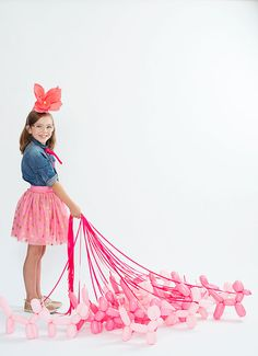 i love all of the pink balloon dogs! // Giant Paper Flower Party Hats | Oh Happy Day!