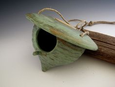 Ceramic Birdhouse Rustic Green Patina by DirtKickerPottery, via Etsy.