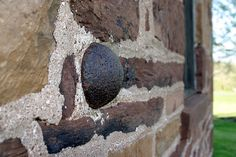 Cannon Ball still wedged in the wall of the Old Stone House