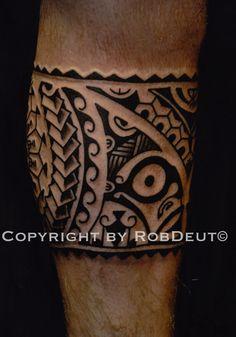 Surfer maori leg tattoo