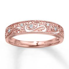 Rose gold with scroll and swirl design. Milgrain detail {what does that mean?}