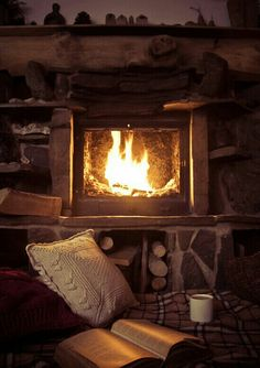 Sitting in a cozy chair, reading a book by a fire