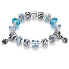 Blue Crystal Murano Charm Bracelet: Don't you just love this gorgeous Blue Murano charm bracelet?  The Blue Crystal Murano bracelet is beautifully decorated with glass beads throughout the entire bracelet as well as exquisite antique silver plated alloy fitting!  This bracelet is perfect if you're looking to add a unique item to your current jewelry collection plus it also makes a great gift for a friend too!   Please Note: Please select chain length of 18cm or 20cm otherwise 20cm will be…