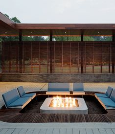 In warm weather, there's nothing like a little outdoor entertaining. At this Missouri house, Hufft Projects carved out a sunken seating area around a firepit. Photo by Mike Sinclair.