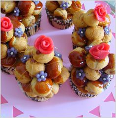 vanilla cupcakes filled with chocolate cream and topped with mini choux pastries