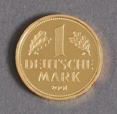 Gold mark 2001 D Federal Republic Germany within a Geschenketui along with 1 DM 1950.    Dealer  Badisches Auktionshaus    Auction  Minimum Bid:  340.00EUR