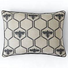 A geometric honeycomb interspersed with bees, printed on natural un-dyed linen cotton