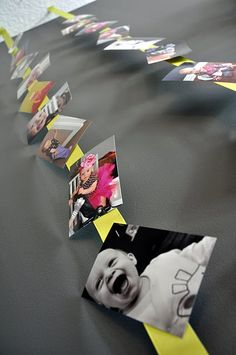Photos on ribbon we take so many pics in preschool this would be a great way to display them. Could even use it by the birthday calendar or show for the slideshow have pics of parties strung up to show how much they have grown...oh the possibilities