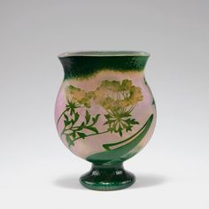 Daum Freres, Nancy. 'Grande berce des pres' martele vase, c1898. H. 22.7 cm. Cased glass, clear, amber and green. Pink powder inclusions. Multiply etched pattern with giant hogweed at sunrise. Ground martele cut. Signed: DAUM NANCY, cross of Lorraine.