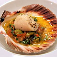 Baked scallops with sauce vierge.