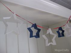 Make this patriotic garland using cookie cutters as templates, via Mega Crafty