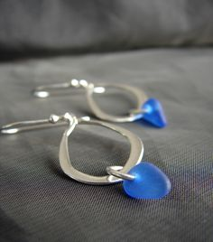 Minimalist style sea glass earrings with tiny drops of genuine cobalt blue sea glass dangling from sterling silver teardrops on sterling silver earwire, the perfect something blue for your beach wedding. Our Waterline earrings are lightweight and have lovely movement. Our sea glass jewelry is pre