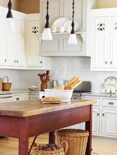 Cut It Out - Enlist the help of a woodworking craftsman to embellish cabinet doors with handiwork. These scrollwork cut-out patterns add Scandinavian style to this Swedish country home.