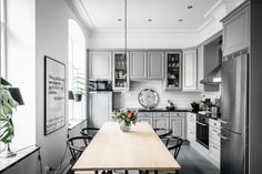 Cool Grey and white kitchen...Love the lights...Gravity Home