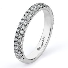 This Michael M Wedding Band Featuring Dual rows of unique U-set pave diamonds create a sparkling accent piece to the  R483 Engagement Ring or wear it alone or stacked for a unique everyday look.