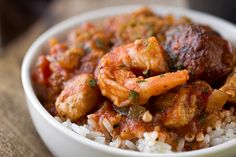 "Full of zesty flavors, this ""Gumbo-laya"" Stew is the best of gumbo and jambalaya in one with spicy sausage, chicken, shrimp and okra over garlic rice Seafood Recipes, Soup Recipes, Cooking Recipes, Okra Recipes, Gumbo Recipes, Tagine Recipes, Prawn Recipes, Creole Recipes, Chicken Recipes"