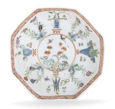 A Worcester octagonal saucer, circa 1753 After a Chinese famille verte prototype, finely painted with 'antiques', vases and precious objects alternating with bifurcated flowering plants and insects, the centre panel with further flowering roots and flying insects, a cross-hatched border in iron red at the rim, 11.3cm wide (tiny chip) £937