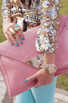 Embellished sequin jacket worn with turquoise pastel skinny jeans and oversized pink clutch