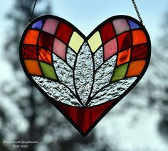 Stained Glass Suncatcher, Heart Shaped Lotus Flower Window Hanging. The lotus flower symbolizes rising from a dark place into beauty and rebirth, as this is exactly how a lotus flower grows. Lotus flowers grow directly out of muddy and murky waters and produce beautiful #FauxStainedGlass