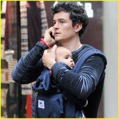 Orlando Bloom: Daddy Duty With Baby Flynn! Orlando Bloom  chats on his cell phone while carrying his son, Flynn, in a baby carrier on Thursday (October 27) in New York City.    The day before, the ...
