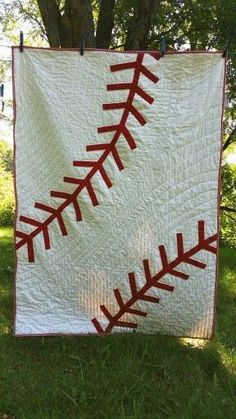 I just finished making this baseball quilt, and I love it. Too bad I'm gifting it! Find a similar one at G And The Bear on Etsy!